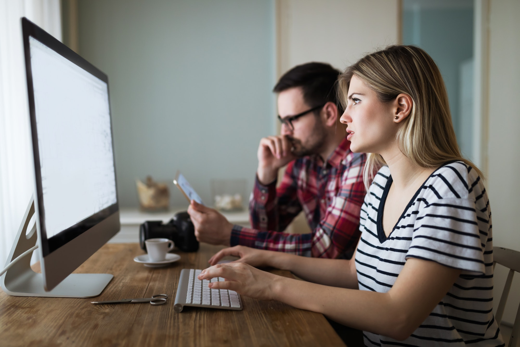 Couple in love working from home